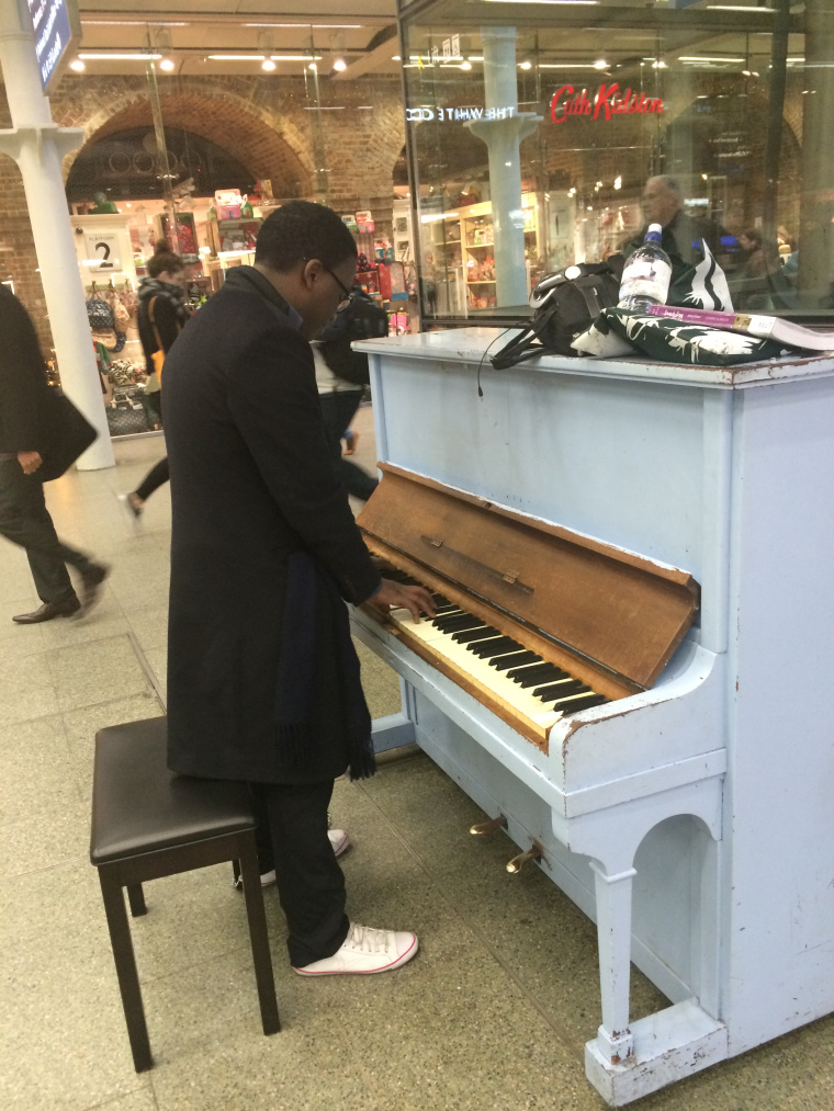 Playing the piano at St Pancras Station before travelling to Paris