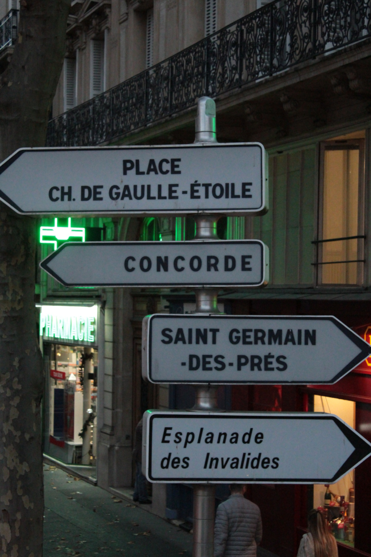 Paris street signs showing 4 destinations