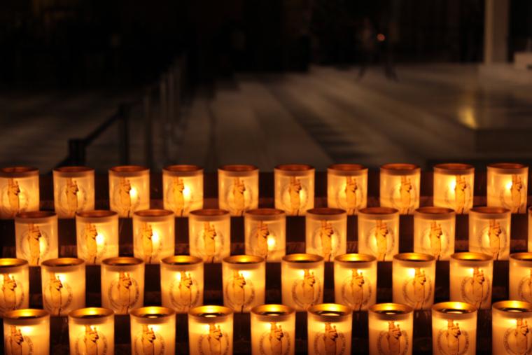 Candles flickering in Notre Dame Paris