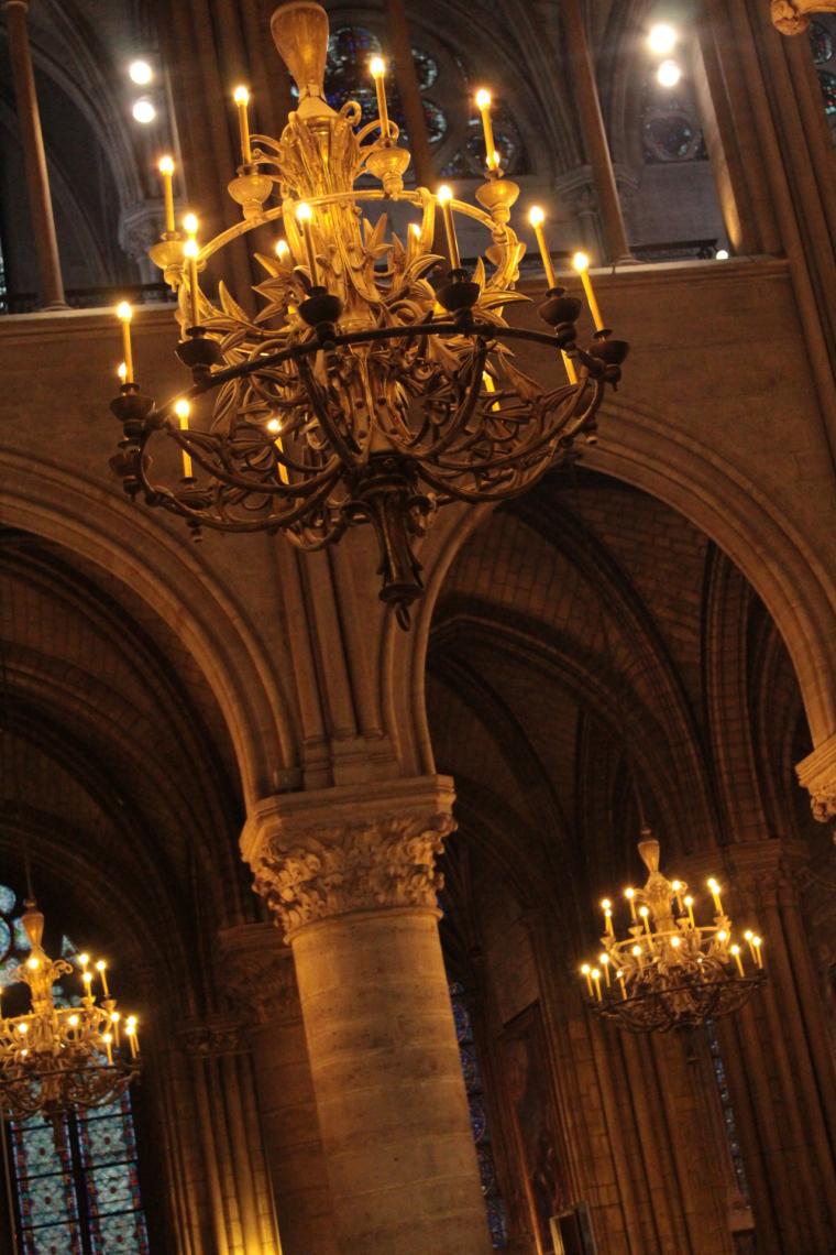 Candelabra lit inside Notre Dame Paris