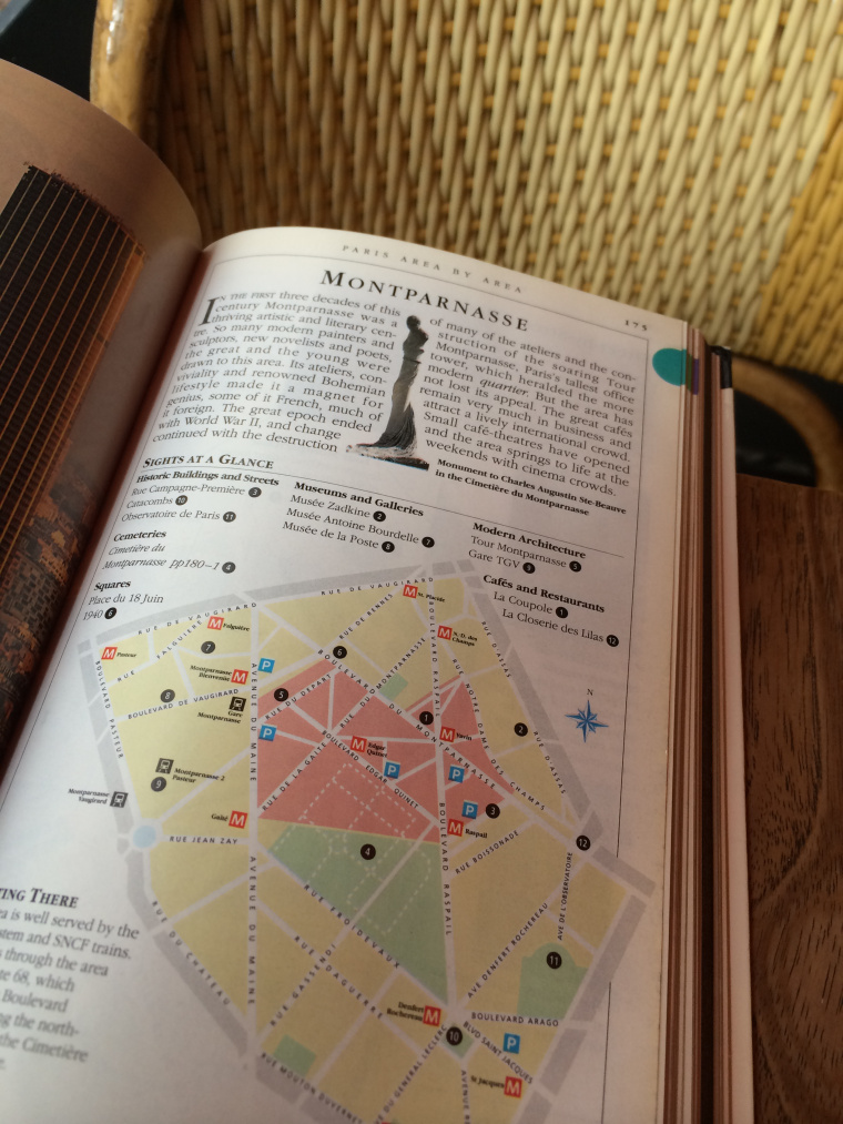 Guide book showing map of Paris neighbourhood