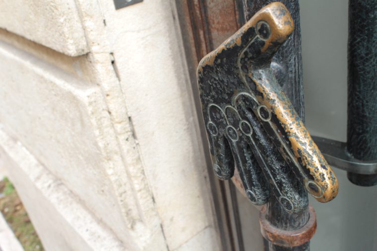 An arty shop door handle in Rue Bonaparte in Paris