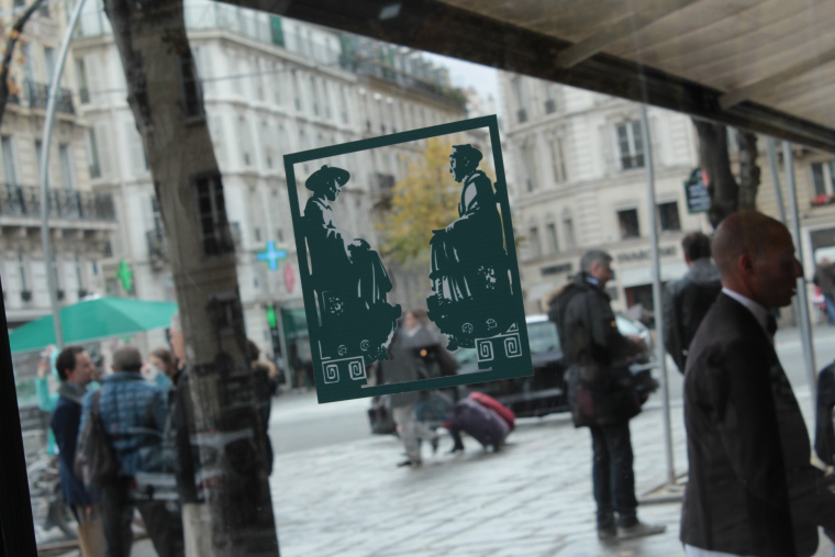 Looking through the window of Cafe Deux Magots Paris
