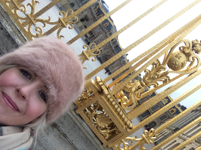Travel Candy outside the golden gates of Versailles