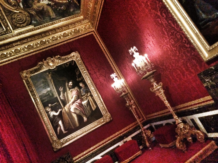 a beautiful red room in Versailles Palace