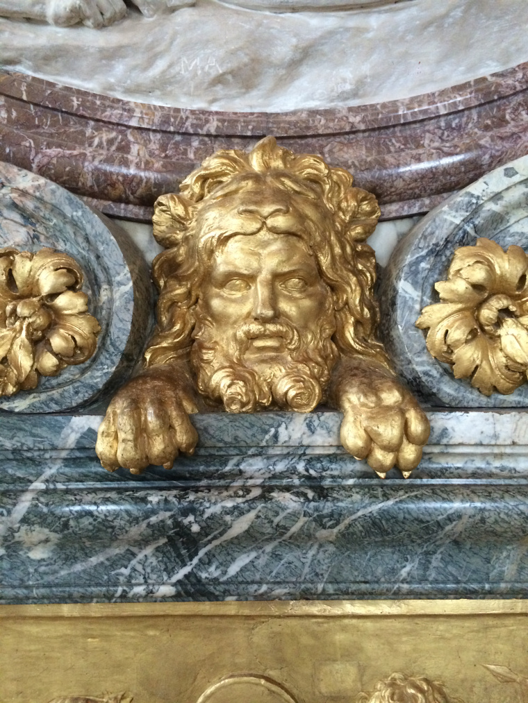 A stunning gold image of the Sun King in Versailles