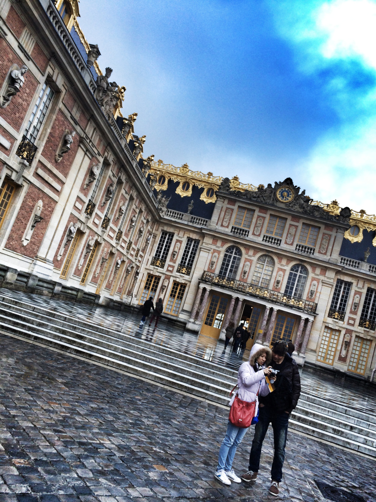 A couple standing outside Versailles Palace