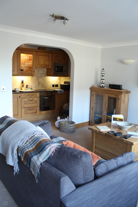 The lounge and kitchen in No. 5 Appletree apartment, northumberland