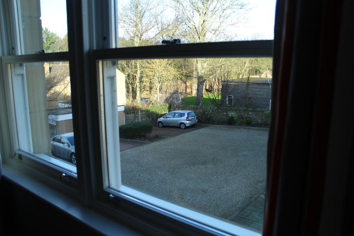 Looking out towards the car park at No.5 Appletree apartment, Beadnell, Northumberland