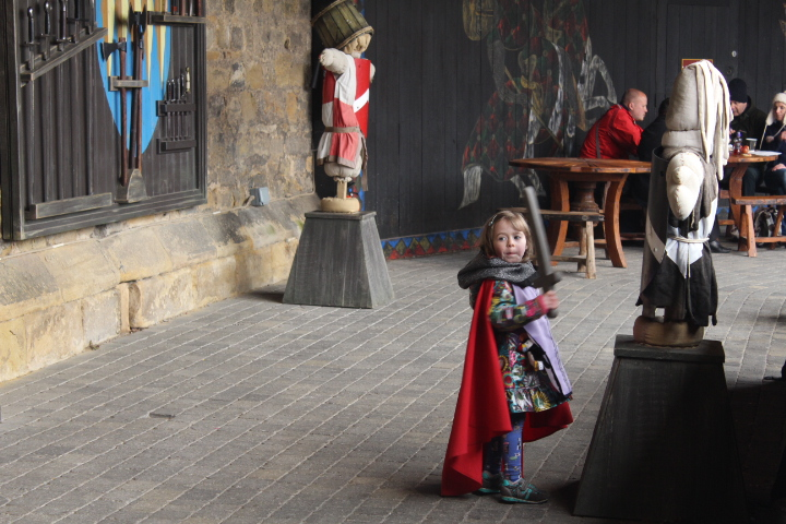 A young knight at Kinghts Quest in Alnwick Castle Northumberland