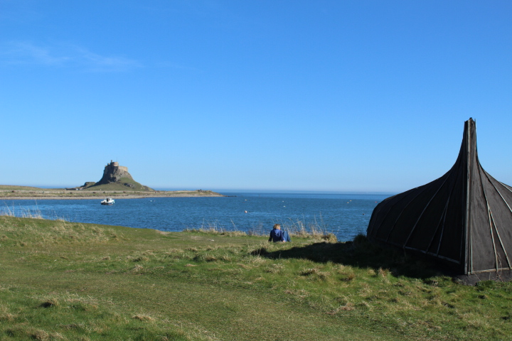 View towards Lindisfarne Castle and an upturned boat