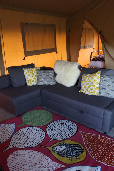 Lounge area in safari glamping tent in wales