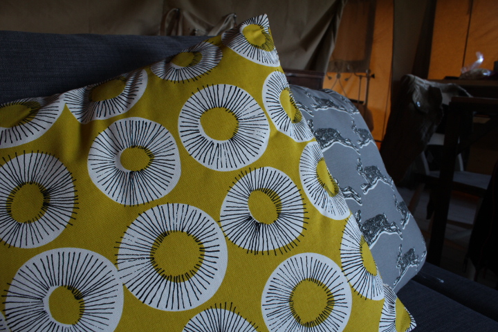 Scatter cushions in our glamping tent
