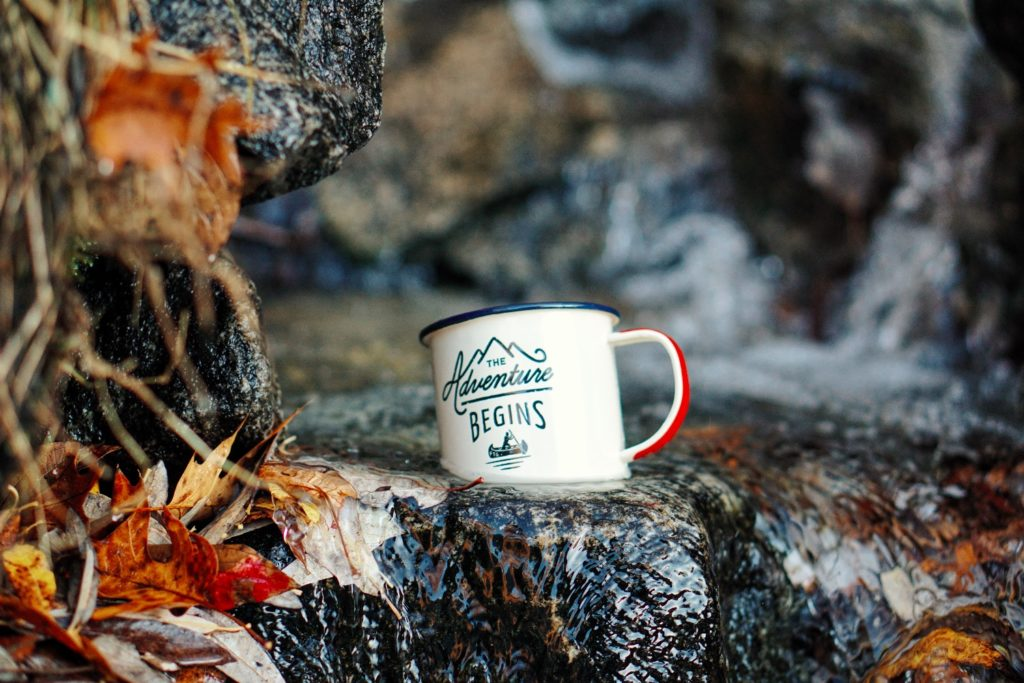 outdoor adventure mug on rocks