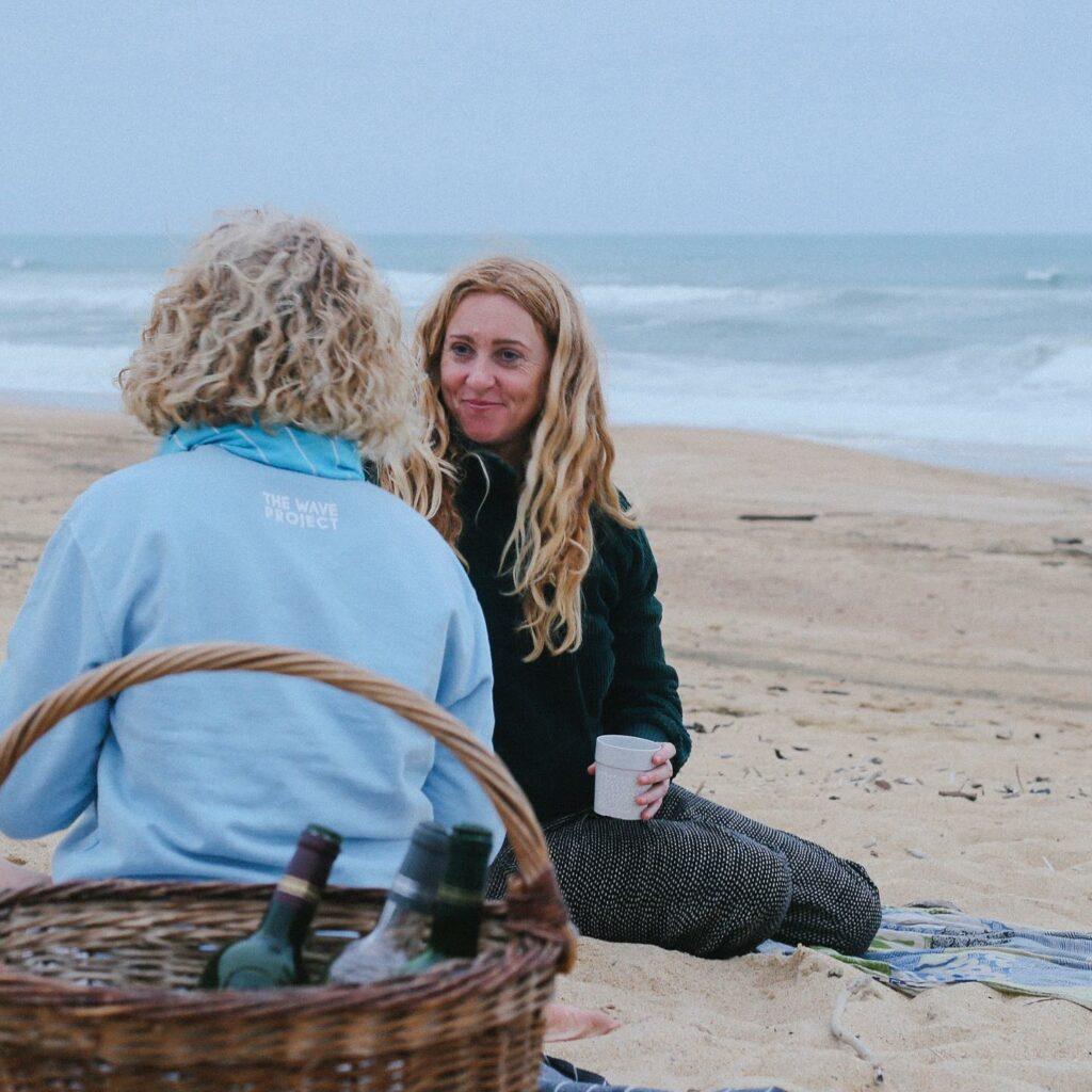 surf sistas - surf retreat on beach