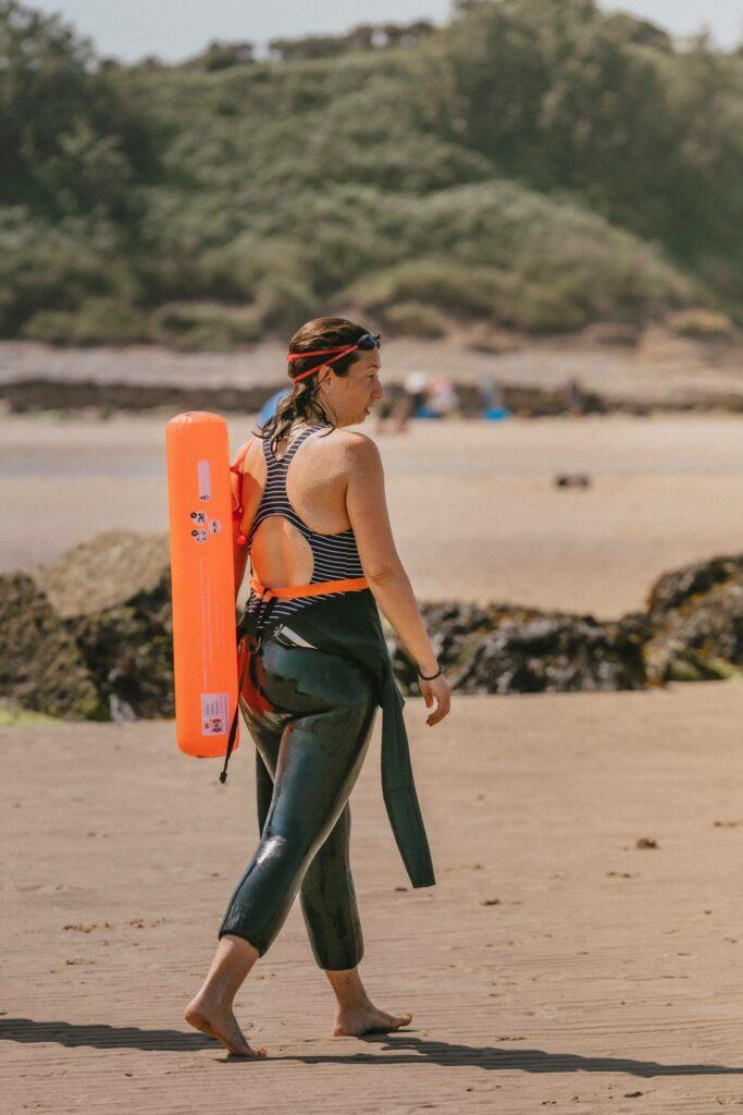 wild swimming retreat wales - lady on beach