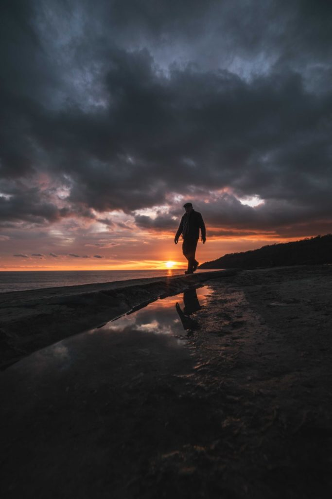 Things-to-do-in-lyme-regis: Simon Emmett photo of man on Cobb