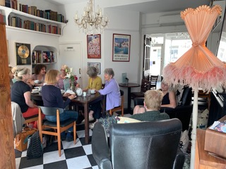 People in Paisnwick Pooch coffee shop