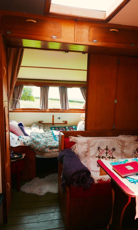Inside glamping van Sybil at Mad Dogs and Vintage Vans