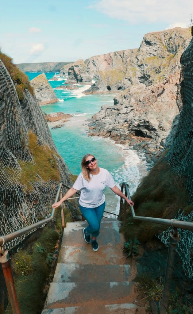 Climbing Bedruthen steps on a girls weekend in cornwall