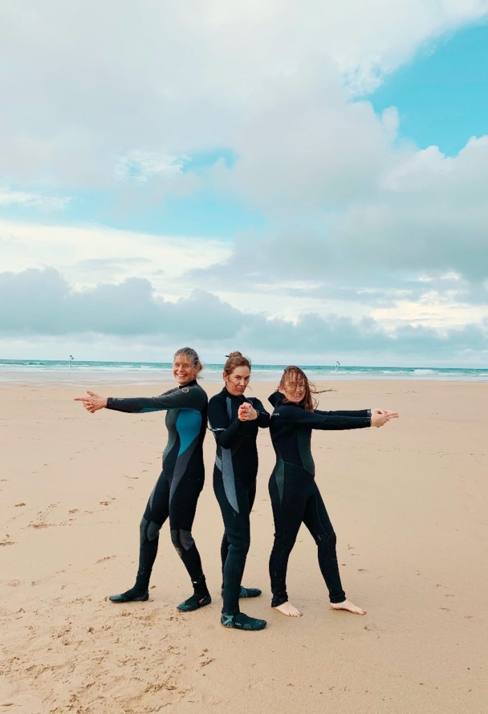 A girls weekend away - four friends in wetsuits