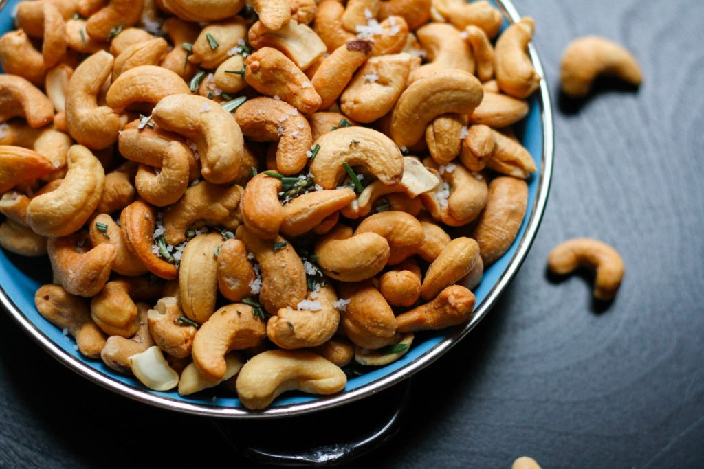 casheews on a blue ceramic plate