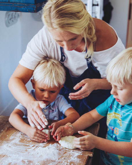Justine Murphy cooking with her children
