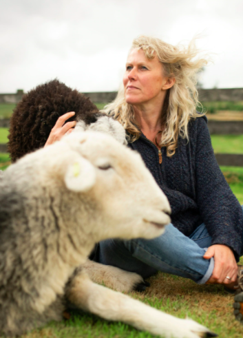 farm owner with sheep