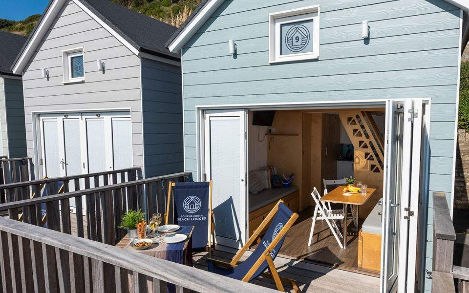 Bournemouth Beach Lodges - Outside decking with deck chairs