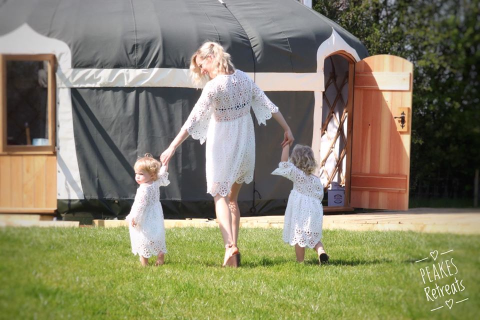 Peake's Retreat Yurts - lady with children walking to yurt