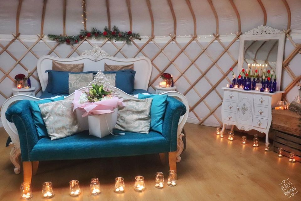 Peake's Retreat Yurts - inside sofa and candles