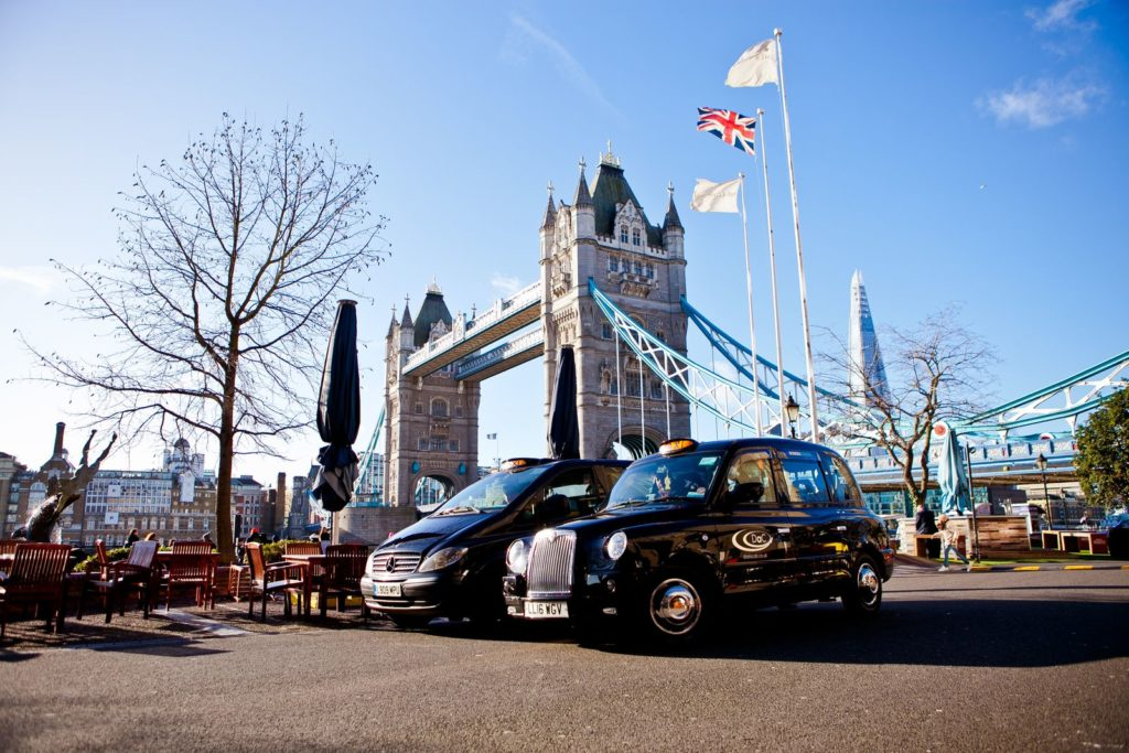 Black taxi tour London cabs at tower of london