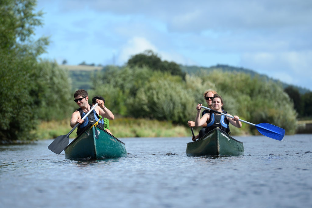 people canoeing down the river wye