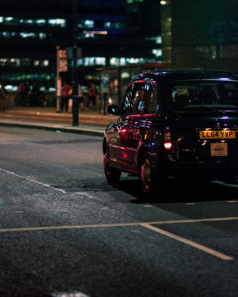 Black taxi tour London cab at night