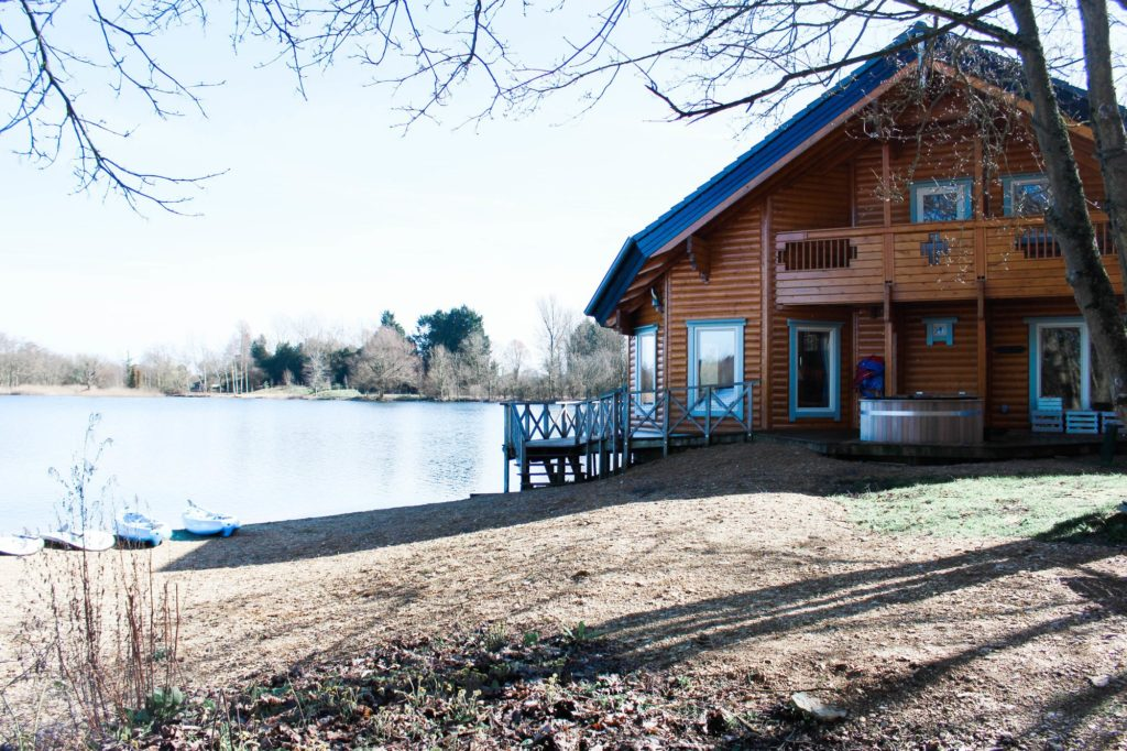 Moondara log cabin in Cotswolds view to lodge with hot tub