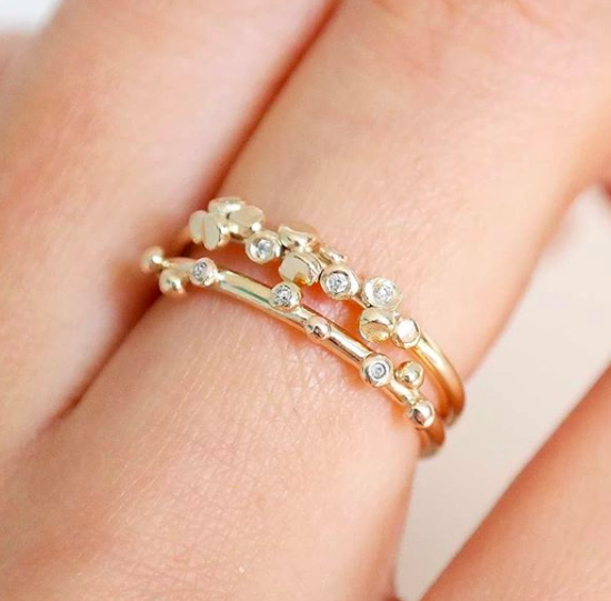 sofi and amia jewellery workshop - gold rings on finger