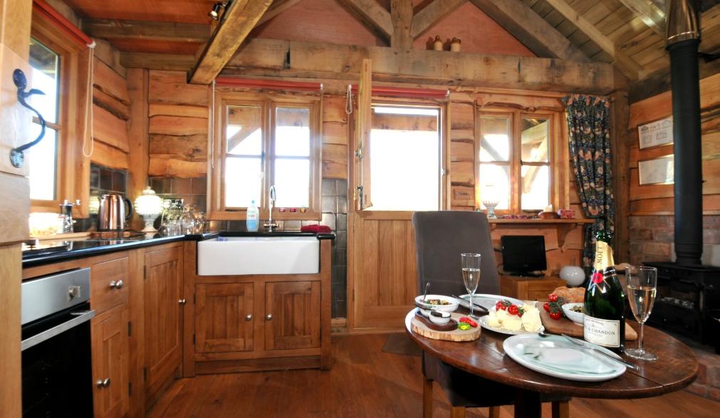 Copperbeech Bowtop Log Cabin and Gypsy Caravan, inside cabin kitchen