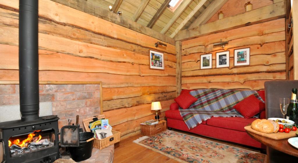 Copperbeech Bowtop Log Cabin and Gypsy Caravan, inside cabin lounge