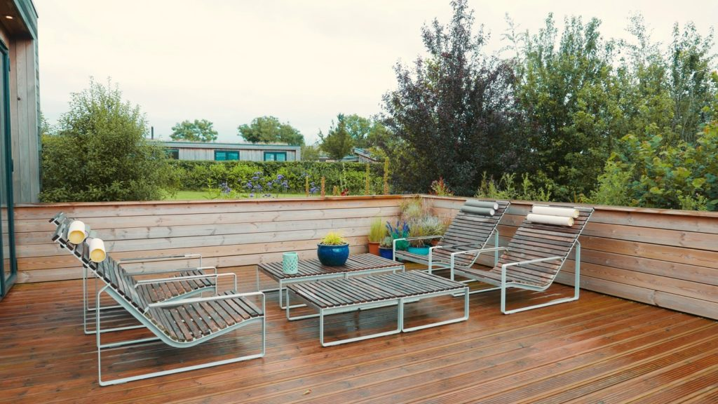 Strawberryfield Eco Lodges in Somerset - deck and loungers
