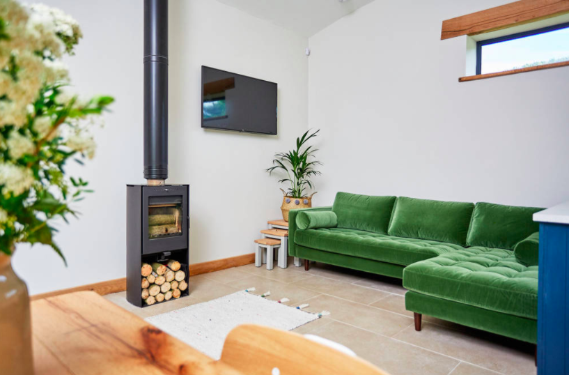The Burrow, Powys, Wales - lounge and green sofa