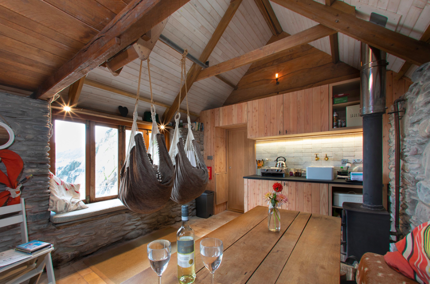 Carswell Farm Beach hut - hanging chairs and interior