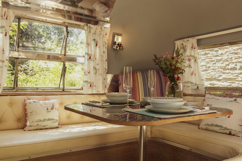 Dixie airstream retro van near lake windermere - dining table inside