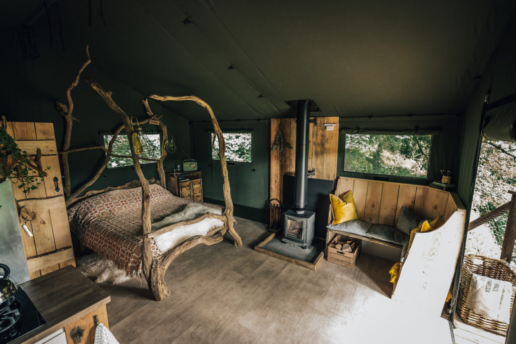 By The Wye - glamping site wye valley safari tent inside living space and log burner