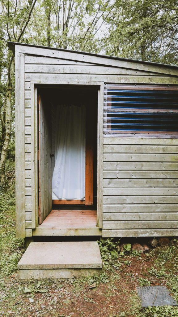 Cwtch camping timber cabins in pembrokshire - shower block outside