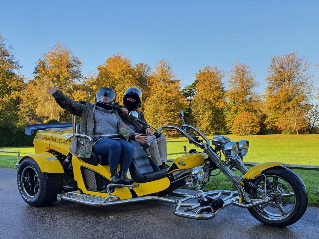 Couple aboard Chiltern Trike Tours with autumn trees