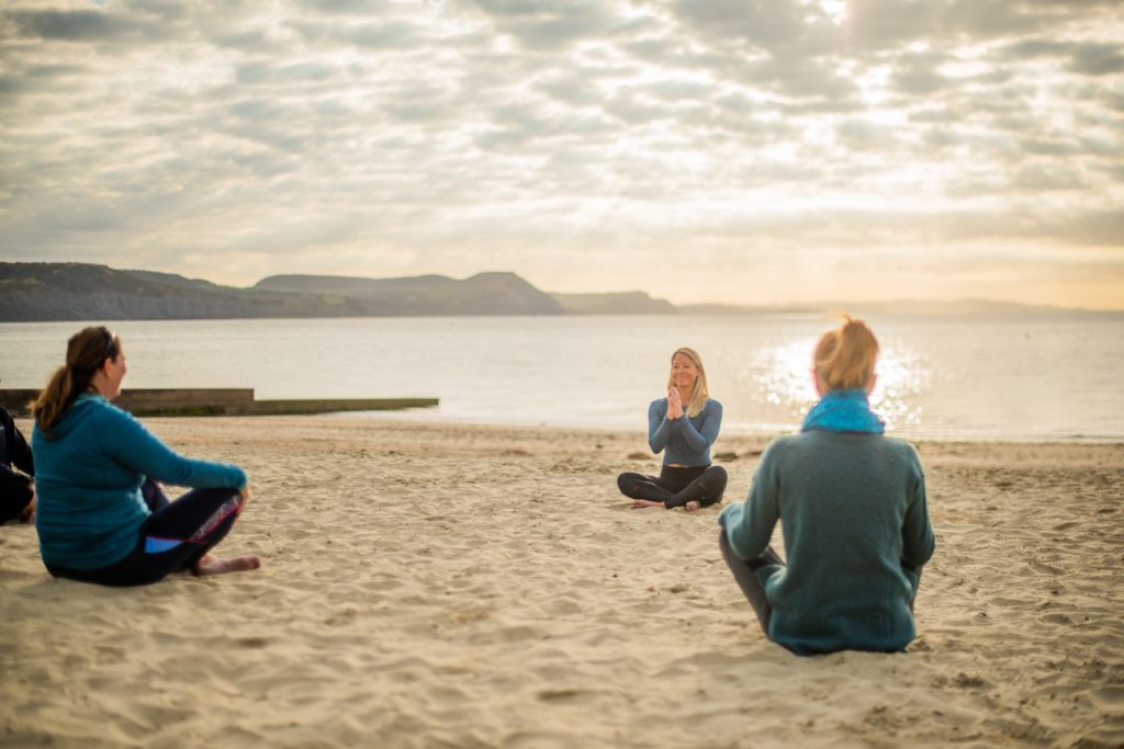 yoga with pip from Maitri Yoga on Lyme Regis beach