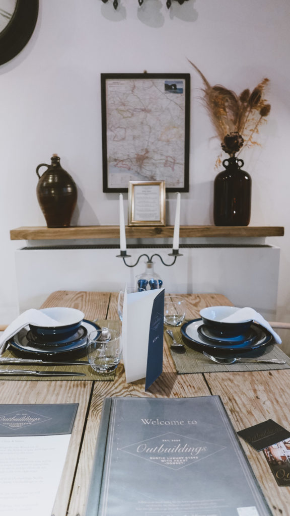 The Farrows dining table and info at the Outbuildings self-catering studios in Dorset