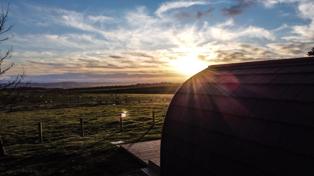 Sycamore glamping pods northumberland - exterior view as sun sets