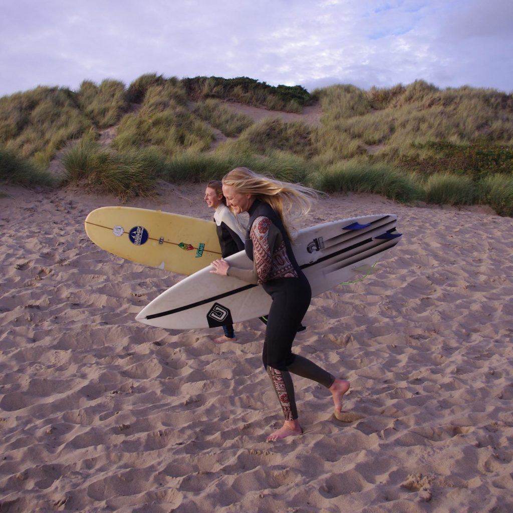 Swell Yoga Retreat North Devon - walking with surf board