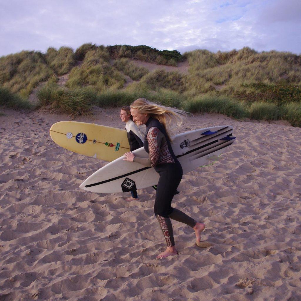 Swell Yoga Retreat North Devon - walking with surf board